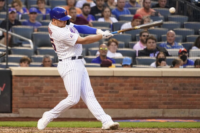 New York Mets' Brandon Drury hits an an RBI single during the eighth inning against the Washington Nationals in the completion of a suspended baseball game Wednesday, Aug. 11, 2021, in New York. (AP Photo/Mary Altaffer)
