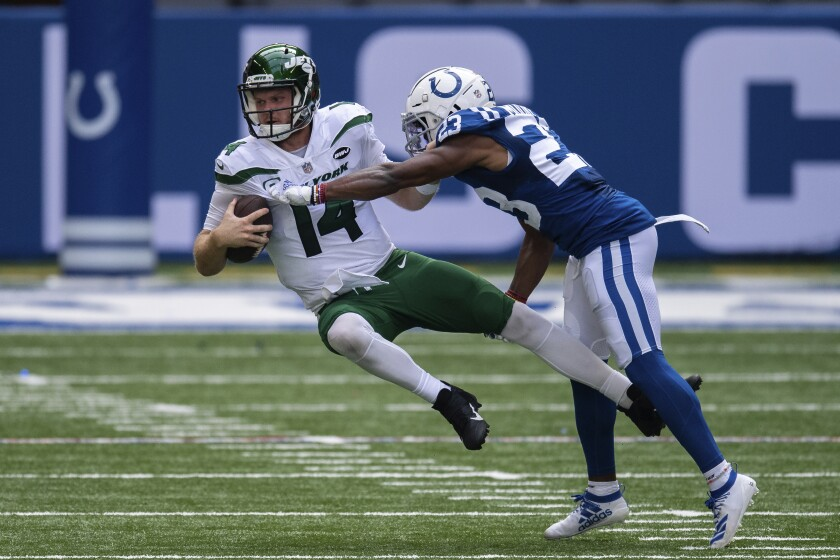 Colts cornerback Kenny Moore sacks New York Jets quarterback Sam Darnold.
