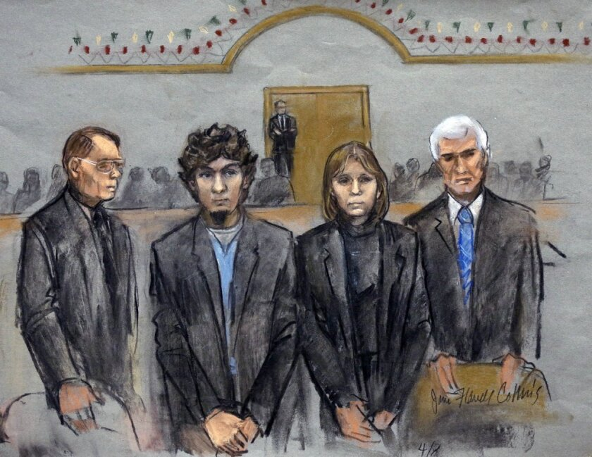 Dzhokhar Tsarnaev, second from left, stands with his attorneys as the jury declares him guilty in the Boston Marathon bombing.