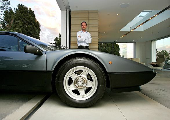 """By Dan Neil Is it a garage or an art gallery with a Ferrari parked in it? Brentwood resident Holger Schubert's 1984 Ferrari 512 BBi """"Boxer"""" makes its home in a 1,200-square-foot space that recently won Maserati and Architectural Digest's Design Driven contest for best garage. Schubert's """"garage"""" -- hereafter I use the word with an asterisk of skepticism — is breathtaking. Beautiful. Exquisite. But where are the tools, the work benches, the girlie calendars? Schubert concedes that it isn't a typical, oil-on-the-floor garage, and he's comfortable with that. """"I wanted to create a backdrop for the car as a piece of art,"""" he says. Tag along for a tour ... Back to L.A. at Home design blog"""