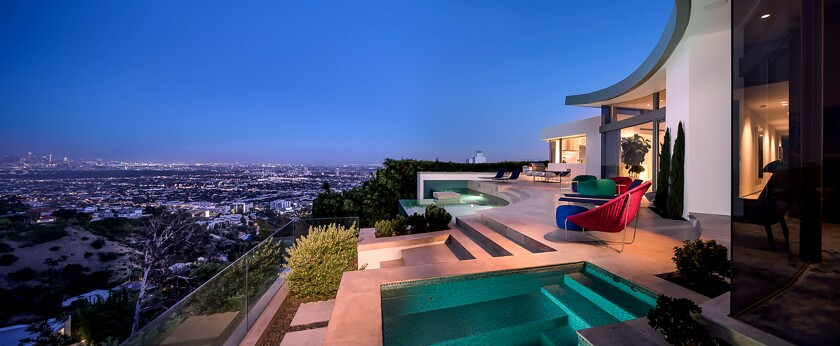 The Hollywood Hills West showplace, listed for $10.9 million, is in the desirable Bird Streets neighborhood, a celebrity-popular enclave known for its avian-themed street names.