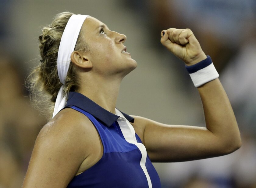 Victoria Azarenka, of Belarus, reacts after a point during a math against Aleksandra Krunic, of Serbia, during the fourth round of the 2014 U.S. Open tennis tournament Monday, Sept. 1, 2014, in New York. (AP Photo/Darron Cummings)