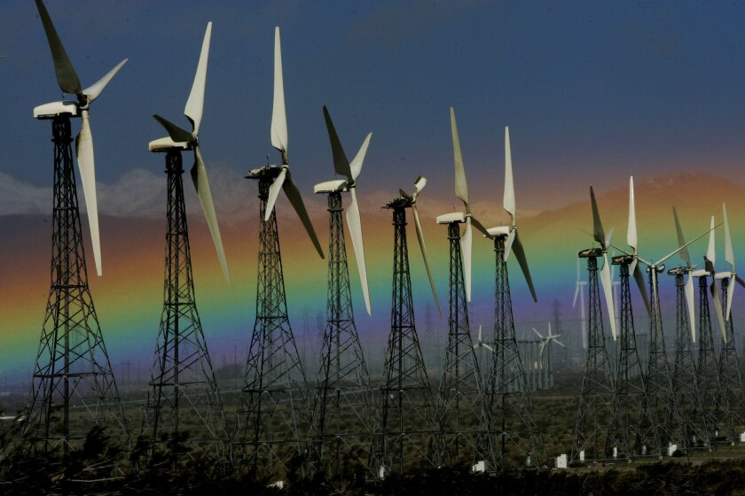 In this Jan. 28, 2008 file photo, a rainbow is visible looking West from Palm Springs, Calif., next to an array of wind turbines. Two decades from now Americans are as likely to be getting their electricity from windmills as from nuclear power plants, the Energy Department says. (AP Photo/Sandy Huf
