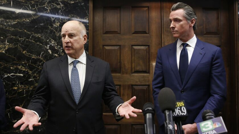 Gov. Jerry Brown, left, responds to a reporter's question following a meeting with Governor-elect Gavin Newsom in Sacramento, Calif. on Nov. 13.
