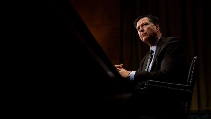 FILE- In this May 3, 2017, file photo, FBI Director James Comey listens while testifying on Capitol