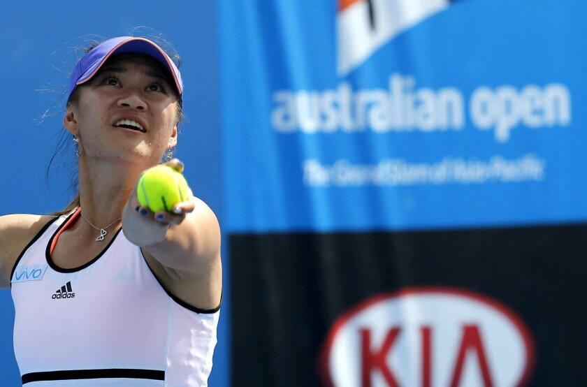 China's Xu Shilin, with playing partner Australia's Sara Tomic, serves as they play Czech Republic's Miriam Kolodziejova and Marketa Vondrousova during junior girls' doubles semifinal at the Australian Open tennis championship in Melbourne, Australia, Thursday, Jan. 29, 2015. Xu, who just turned 17
