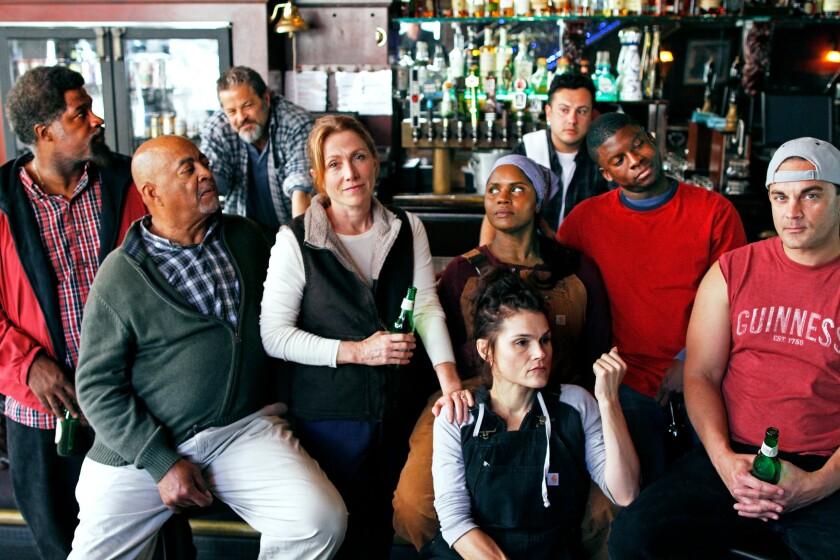 "Cast members Matt Orduña (from left), Antonio TJ Johnson, Jeffrey Jones, Judy Bauerlein, Hannah Logan, Monique Gaffney, Markuz Rodriguez, Cortez Johnson and Steve Froehlich of San Diego Rep's ""Sweat."""