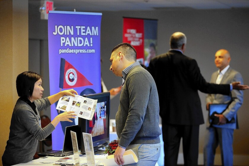 Job seekers meet with recruiters during a HireLive career fair in San Francisco. The labor market has failed to keep up with population growth and continues to struggle to create higher-wage jobs.