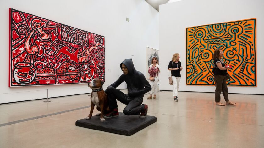 """LOS ANGELES, CALIF. - APRIL 23: People walk through the gallery, in view of Keith Hering's """"Red Room"""