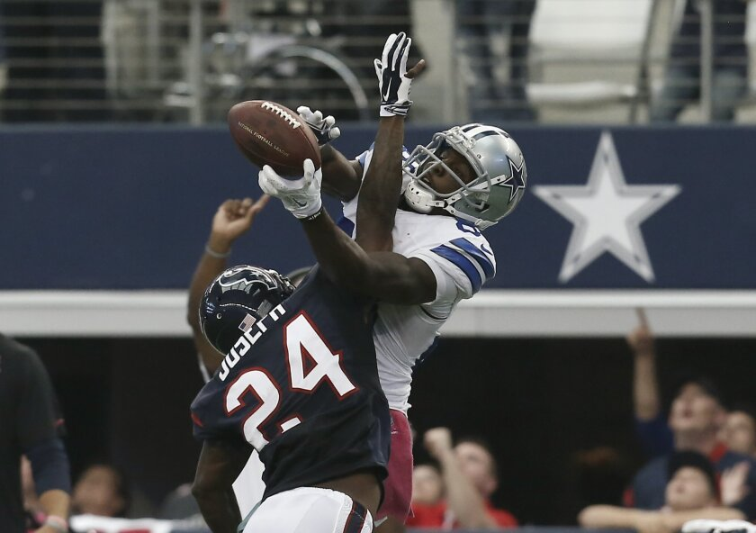 Dallas Cowboys wide receiver Dez Bryant (88) grabs a pass over Houston Texans' Johnathan Joseph (24) in overtime of an NFL football game, Sunday, Oct. 5, 2014, in Arlington, Texas. The reception help set up a field goal by the Cowboys that gave them the 20-17 win. (AP Photo/Brandon Wade)