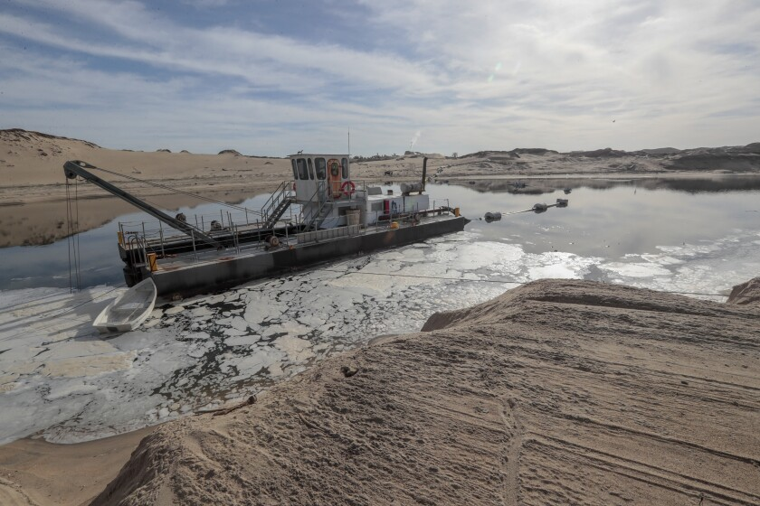 Dredging vessel in Marina Dunes