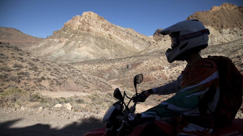 On the dirt road to Titus Canyon, Mark Buche takes a moment to take in a desert view in Death Valley National Park.