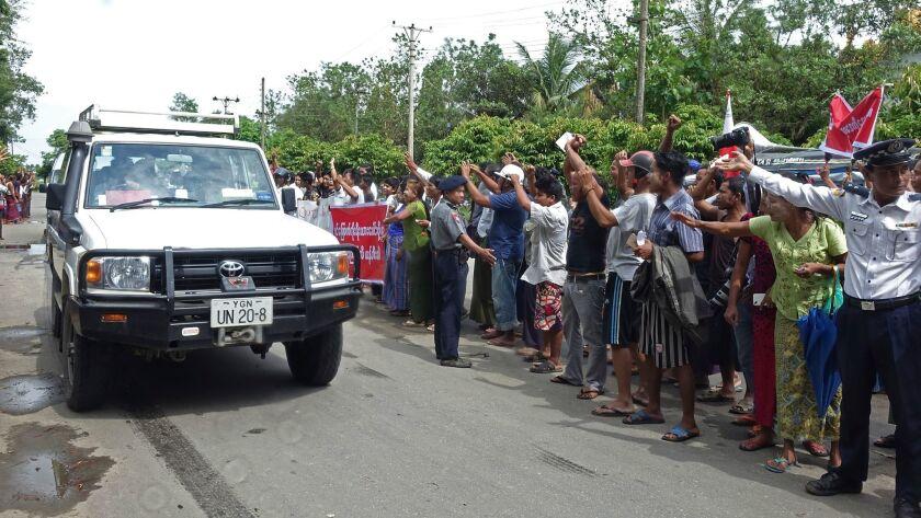 Demonstrators protest as the motorcade of Yanghee Lee, U.N. Special Rapporteur on Human Rights, passes through Sittwe, Myanmar on July 12.
