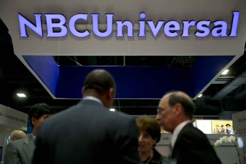 The logo of Comcast Corp.'s NBCUniversal is seen on the exhibit floor during the National Cable and Telecommunications Assn. Cable Show in Washington.