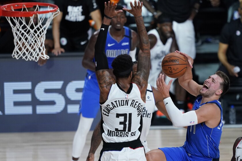Clippers' Marcus Morris Sr. covers Dallas Mavericks' Luka Doncic