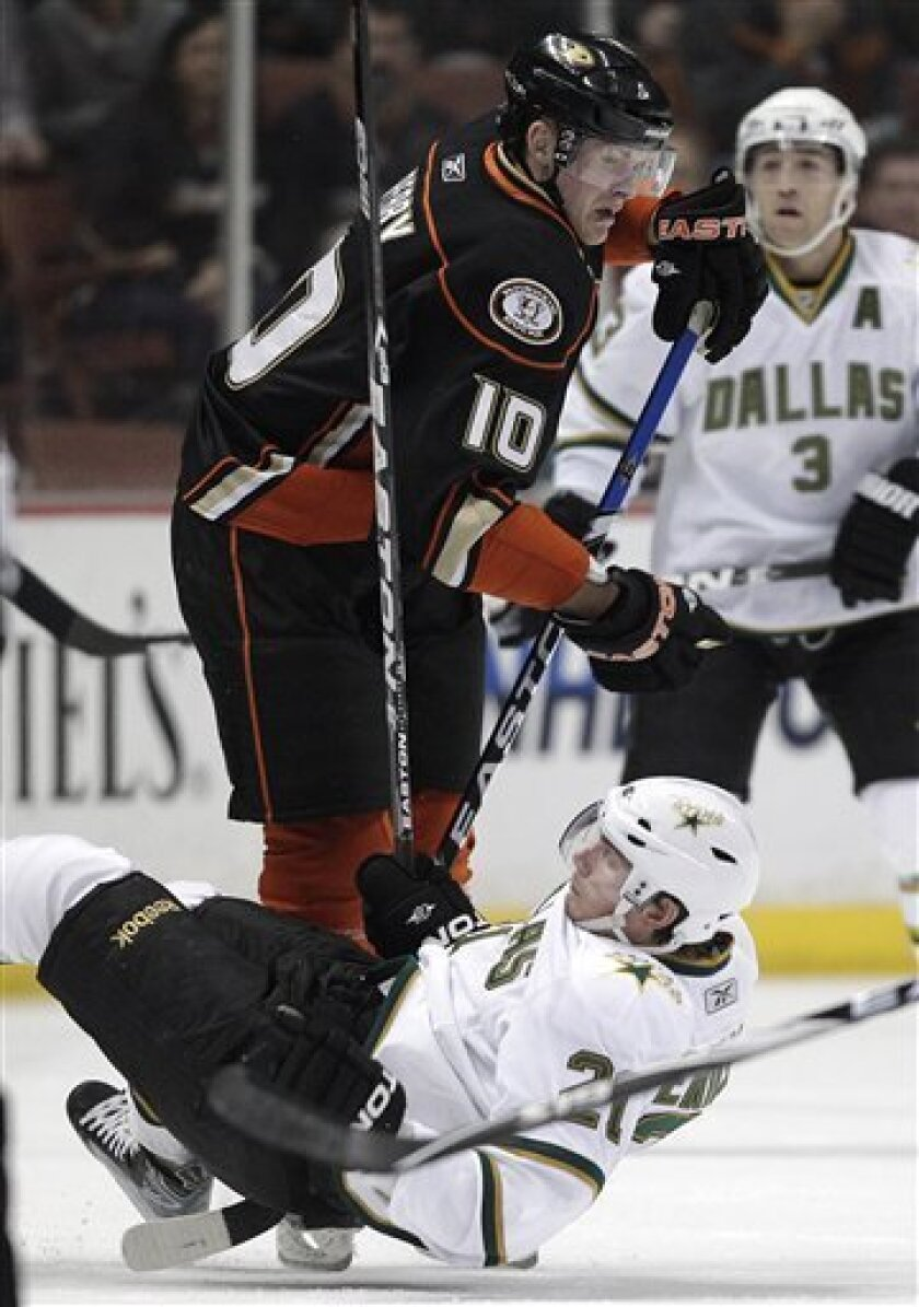 Dallas Stars left wing Loui Eriksson, bottom, of Sweden, falls to the ice after colliding with Anaheim Ducks right wing Corey Perry in the first period of an NHL hockey game in Anaheim, Calif., Friday, March 4, 2011. (AP Photo/Jae C. Hong)