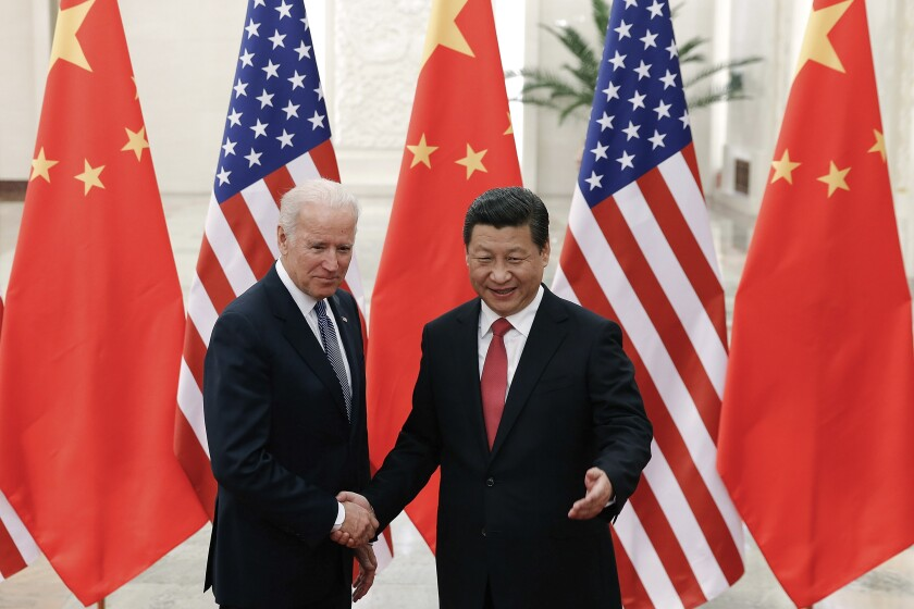 Joe Biden shakes hands with Chinese President Xi Jinping in 2013.