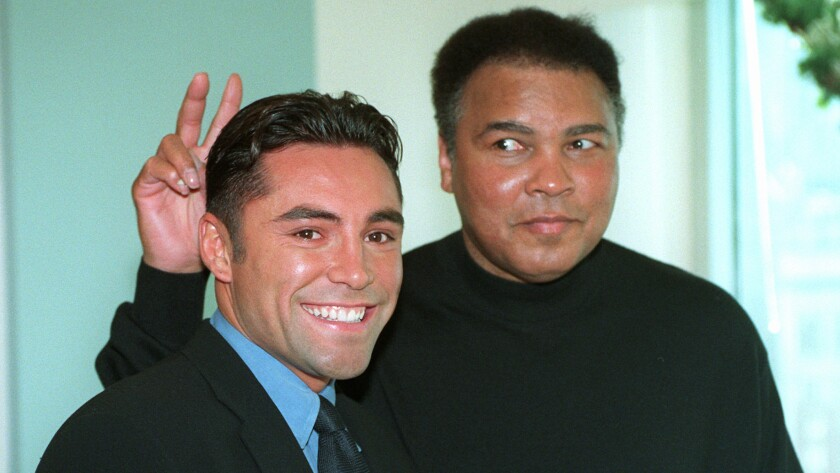 Boxing legend Muhammad Ali, right, clowns around with Oscar De La Hoya while appearing together in New York on Dec. 2, 1997.