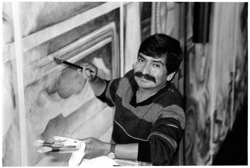 Mexico City artist Gilberto Ramirez at work on his series of three murals in SDSU's Aztec Center in 1970. Photo courtesy of the SDSU Dept. of Special Collections and University Archives.