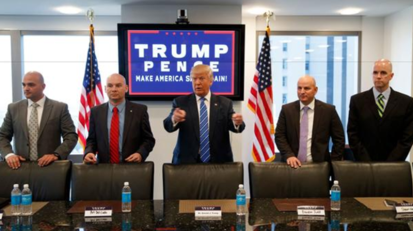 Republican presidential candidate Donald Trump meets with members of the National Border Patrol Council at Trump Tower, Friday, Oct. 7, 2016, in New York. Shawn Moran is at right.