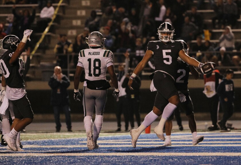 St. John Bosco quarterback DJ Uiagalelei scores on a keeper against Concord De La Salle