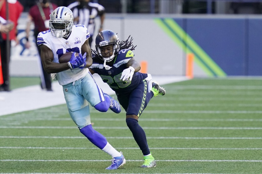 Dallas Cowboys wide receiver Michael Gallup makes a catch as Seattle Seahawks cornerback Shaquill Griffin (26) defends during the second half of an NFL football game, Sunday, Sept. 27, 2020, in Seattle. (AP Photo/Elaine Thompson)