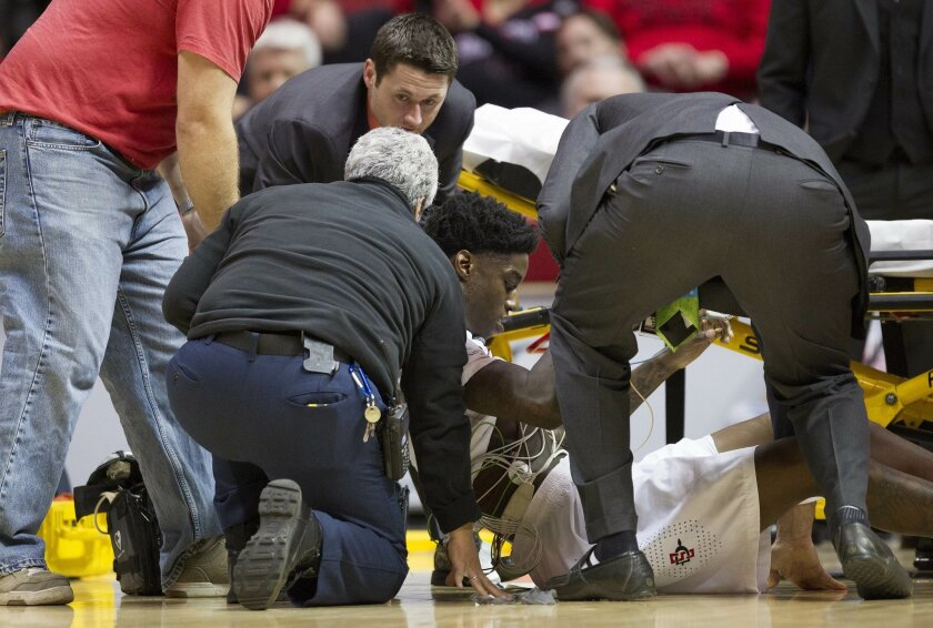 Aztecs forward Dwayne Polee II is lifted up and put on a stretcher after collapsing on the court during SDSU's game with UC Riverside at Viejas Arena.