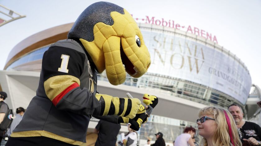 Chance, the Golden Knights mascot, greets hockey fans Saturday outside T-Mobile Arena in Las Vegas. The Knights will take on the L.A. Kings on Wednesday in the first round of the Stanley Cup playoffs.