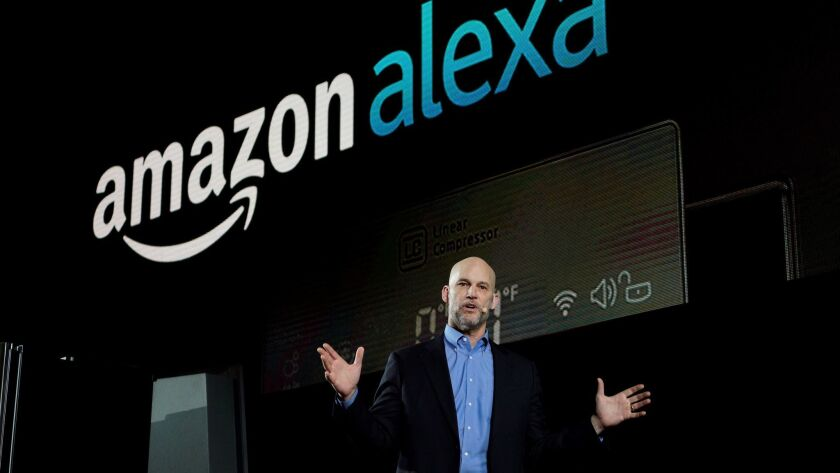 Mike George, VP Alexa, Echo and Appstore for Amazon, speaks during the LG press conference at CES in Las Vegas.
