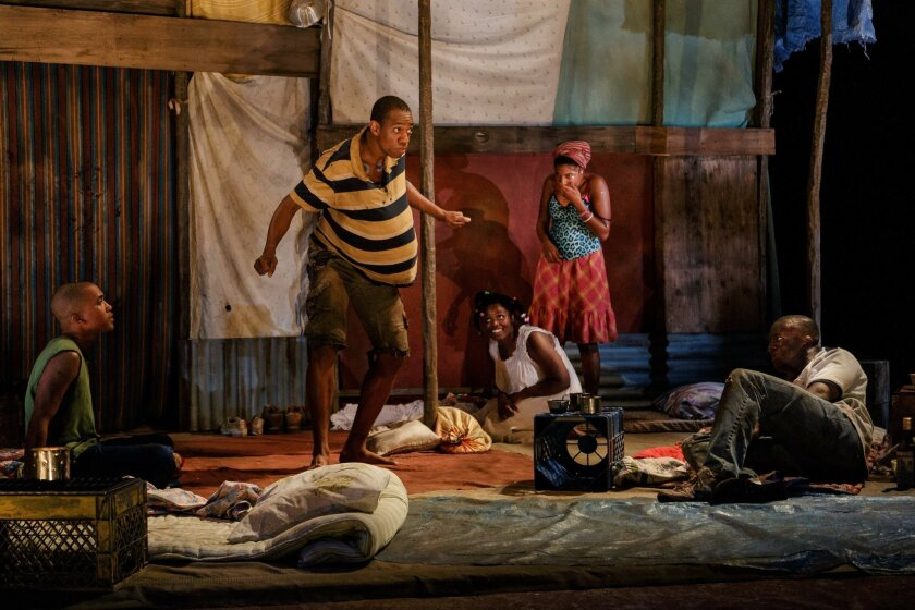 """From left: Clinton Roane, Reggie D. White, Brittany Bellizeare, Jasmine St. Clair, Andy Lucien in La Jolla Playhouse's world premiere of """"The Last Tiger in Haiti,"""" by Jeff Augustin, directed by Joshua Kahan Brody, running in the Mandell Weiss Forum June 28 to July 24. Jim Carmody photo."""