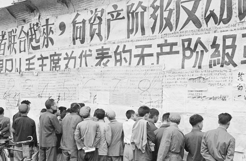Chinese citizens view writings and slogans emblazoned on a wall on Nov. 1, 1967, at the height of the decade-long Cultural Revolution.