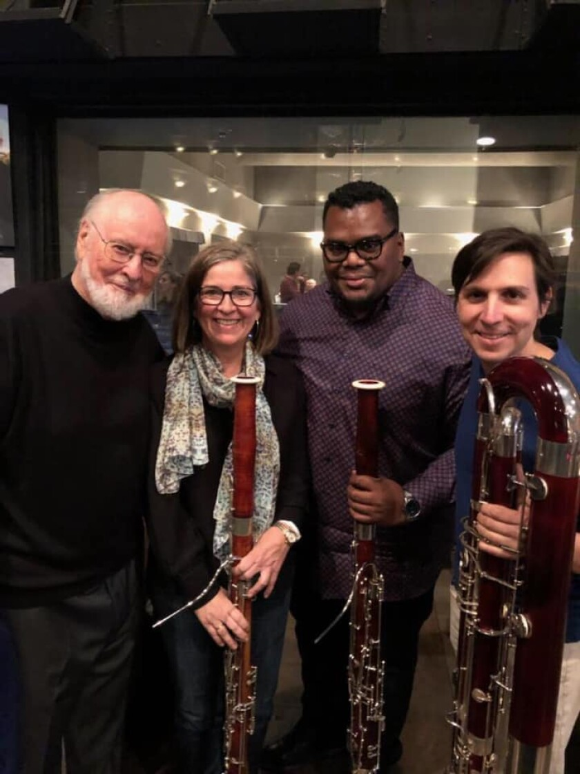 Anthony Parnther, third from left, with composer John Williams, left, and bassoonists Rose Corrigan and Damian Montano.