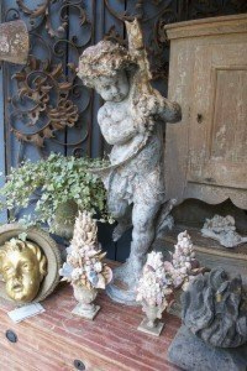 French garden decor lends elegance and beauty to outdoor living spaces.