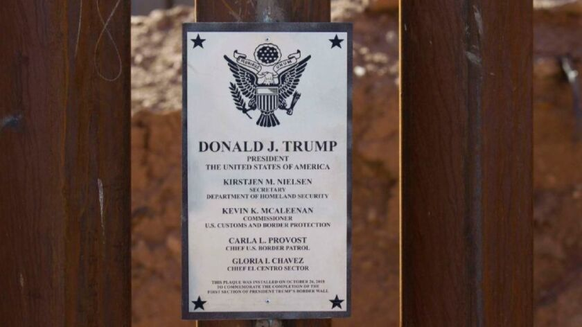 Department of Homeland Security Kirstjen Nielsen visited the recently completed 2 mile section of 30 foot tall border fence west of the Calexico Port of Entry. DHS weldors affixed a plaque to the wall with President Trump's name at the top.