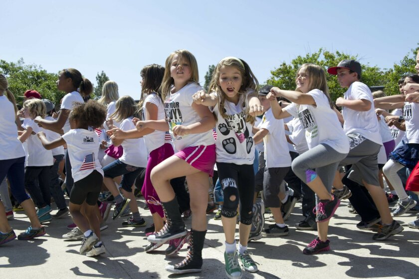 "In this file photo from 2013, students at Green Elementary School in San Diego dance as a part of the federal ""Let's Move"" Campaign that encourages physical fitness to combat childhood obesity. / photo by Andy Wilhem * U-T"