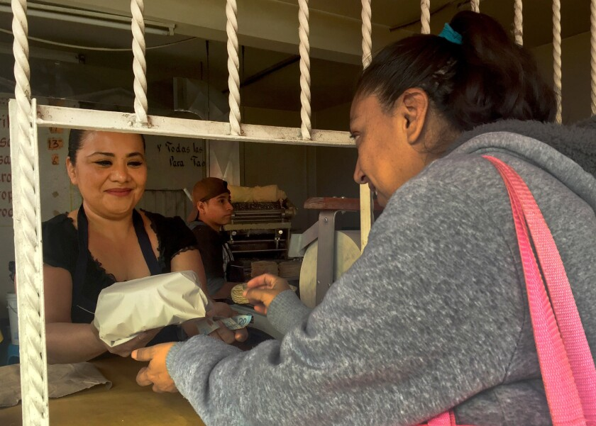 Sophia Cruz, left, who owns a corner store called Tortilleria Mexico in Nezahualcoyotl, Mexico, has refused to lower prices for her tortillas. She's lost business to others that receive assistance from a local political candidate in exchange for free advertising.