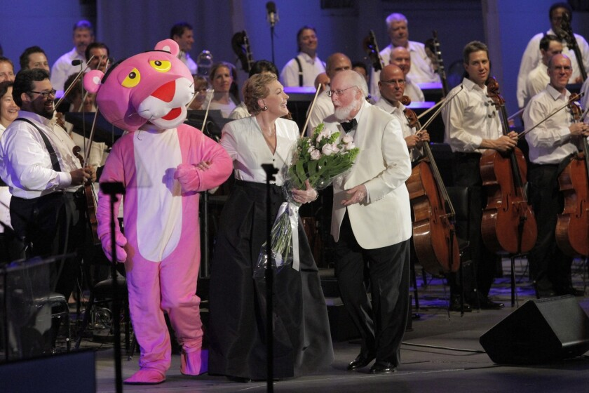 The Pink Panther character poses with Julie Andrews and composer/conductor John Williams after a tribute to director Blake Edwards and composer Henry Mancini at the Hollywood Bowl.