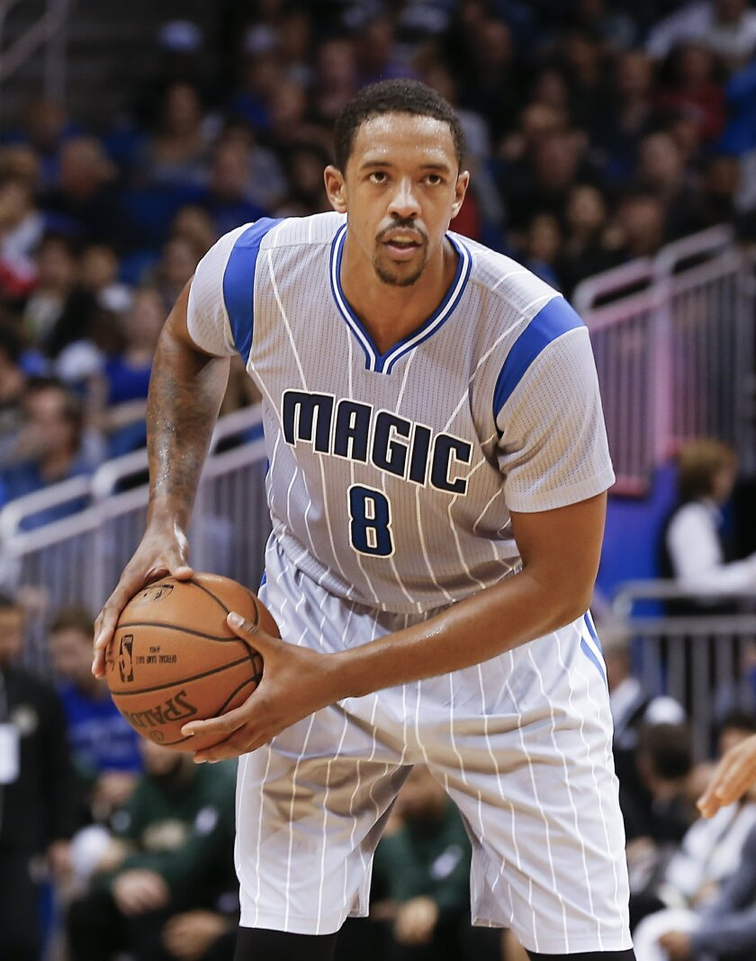FILE - In this Nov. 27, 2015, file photo, Orlando Magic forward Channing Frye (8) drives during the second quarter of a basketball game against the Milwaukee Bucks, in Orlando, Fla. Two people with knowledge of the deal say the Cavaliers have acquired forward Channing Frye from the Orlando Magic in