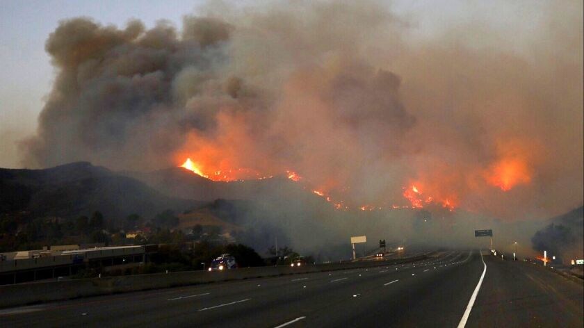 The Woolsey fire burns in the hills off the 101 Freeway at Cheseboro Road in Agoura Hills on Nov. 9.