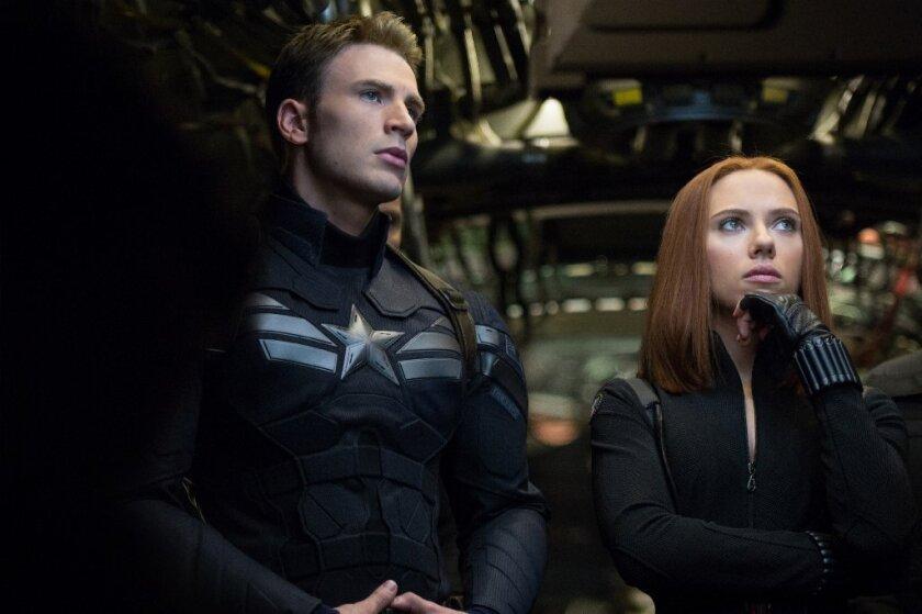 "Chris Evans and Scarlett Johansson in the Marvel superhero sequel, ""Captain America: The Winter Soldier."""