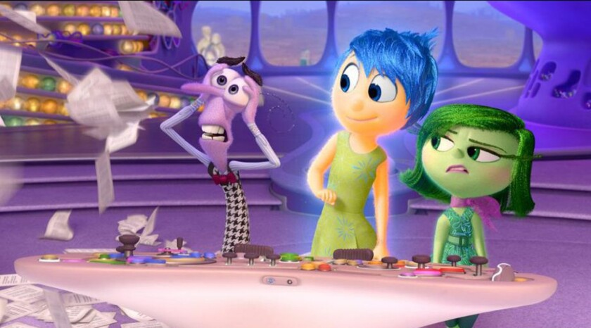 """A scene from """"Inside Out"""" showing Fear, left, (voiced by Lewis Black), Joy (Amy Poehler) and Disgust (Mindy Kaling)."""