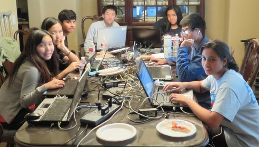 Competing in a preliminary round of the sixth annual San Diego Mayor's Cyber Cup are Del Norte High students, from left, Madeleine Tran, Yeonjae Hong, Vishrut Gupta, Kevin Ma (team captain), April Xie, Ashwath Raj and Vidya Jayaraman. Not pictured is Samantha Tran (Cyber Patriot Club president).
