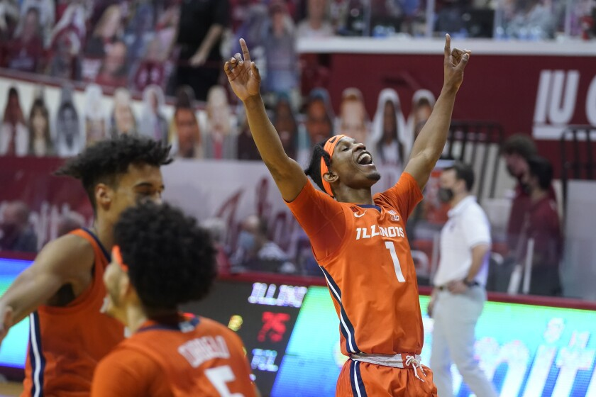 Illinois' Trent Frazier (1) celebrates after Illinois defeated Indiana 75-71 in overtime during an NCAA college basketball game Tuesday, Feb. 2, 2021, in Bloomington, Ind. (AP Photo/Darron Cummings)