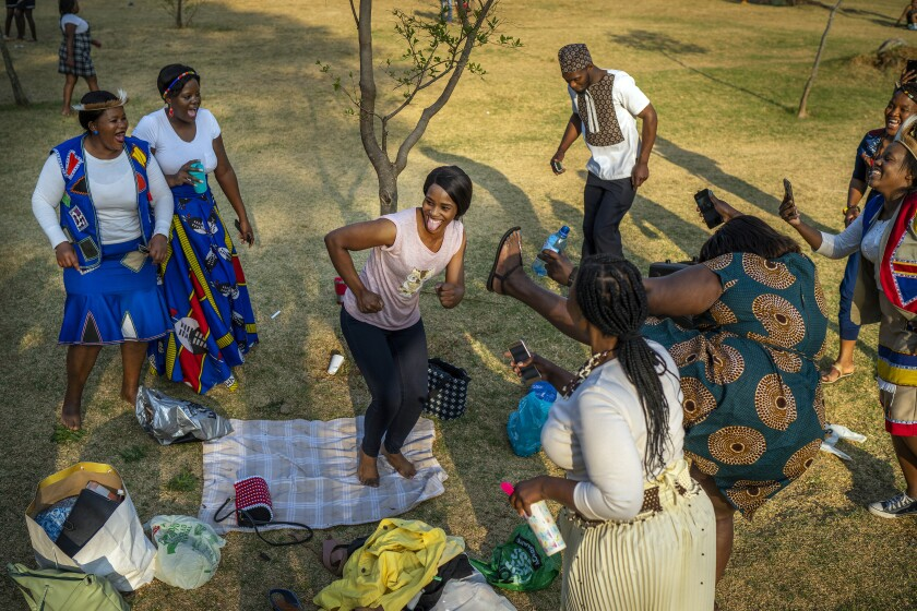 People celebrate South Africa's Heritage Day by dancing at Zoo Lake park in Johannesburg on Thursday