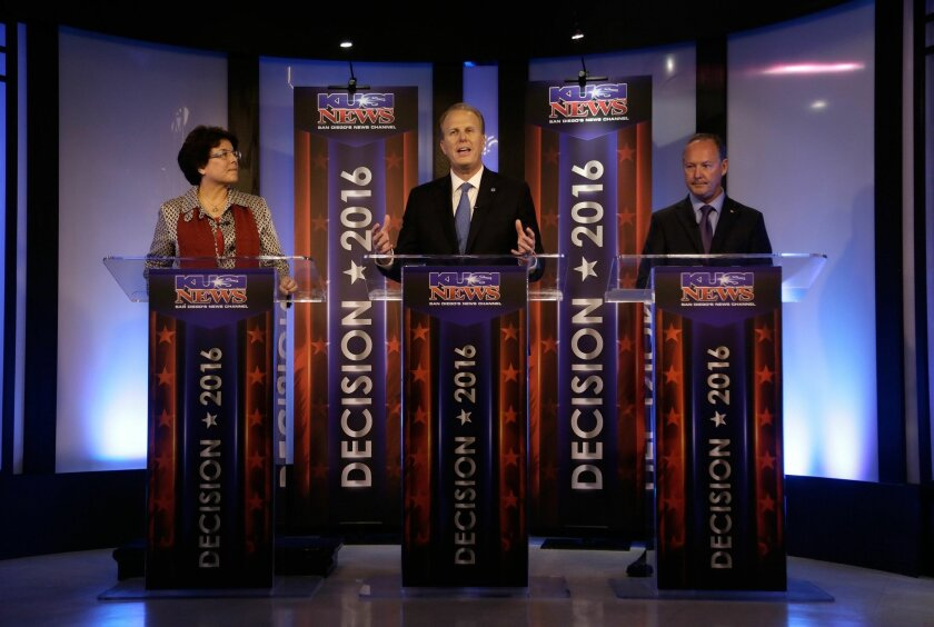 .From left to right, San Diego Mayoral candidates Lori Saldaña, Kevin Faulconer, and Ed Harris participate in a mayoral debate on KUSI Tuesday night. .