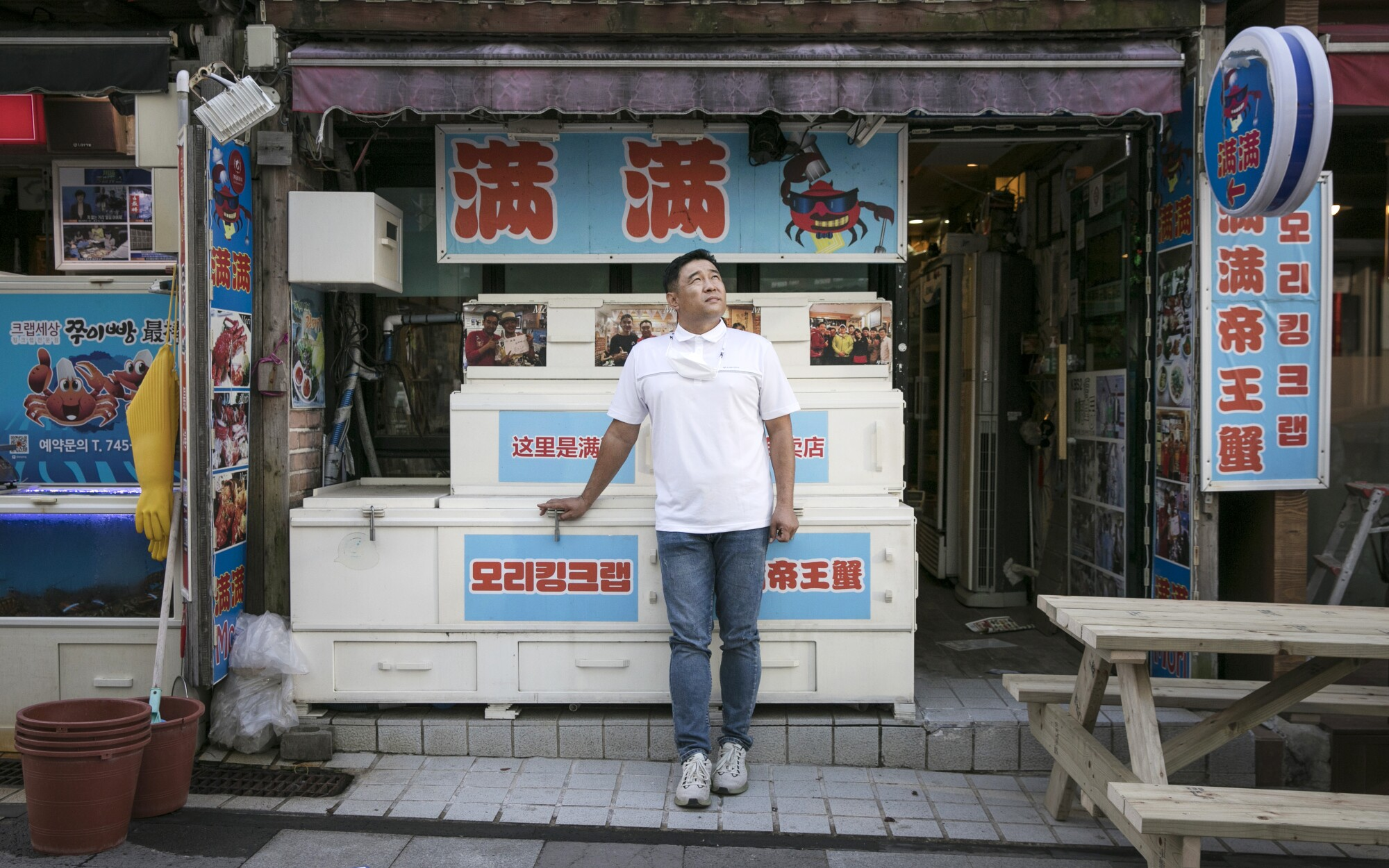 Kim Kyoung-chul stands at the entrance to his restaurant  on Jeju Island.