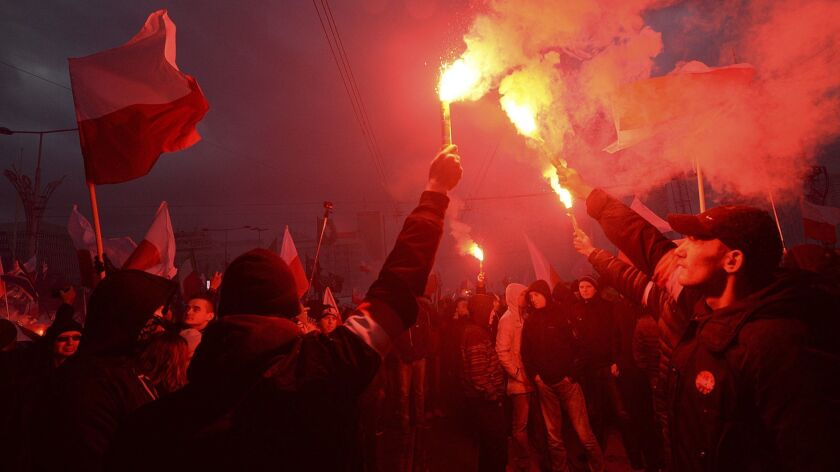 In November 2017, demonstrators burn flares and wave Polish flags during the annual march to commemorate Poland's National Independence Day in Warsaw. Thousands of nationalists took part in an event that was organized by far-right groups last year.