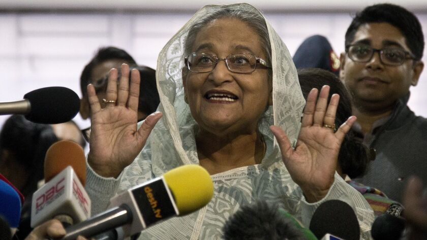 Bangladesh Prime Minister Sheik Hasina Wajed speaks to the media after casting her vote in Dhaka.