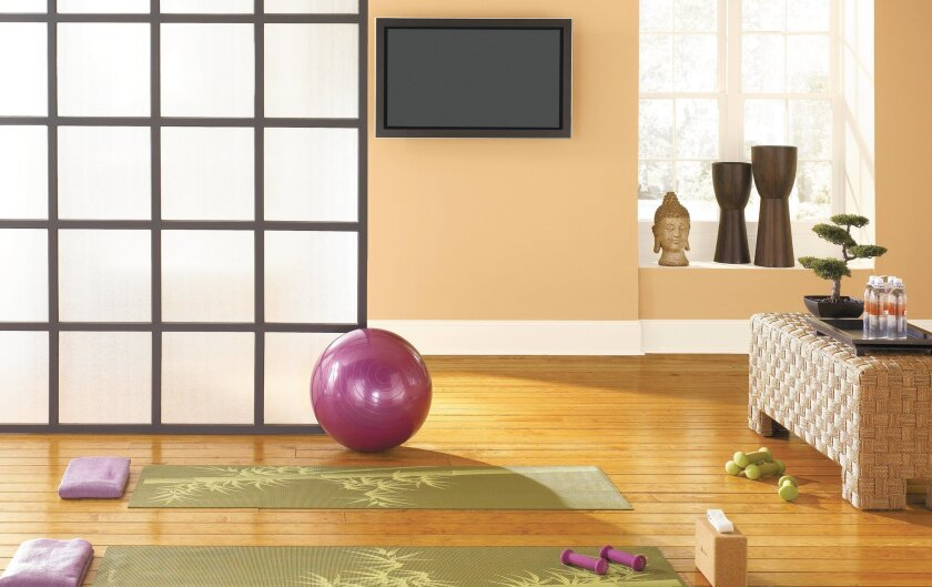 Soft neutrals and wood floors work well for yoga spaces.