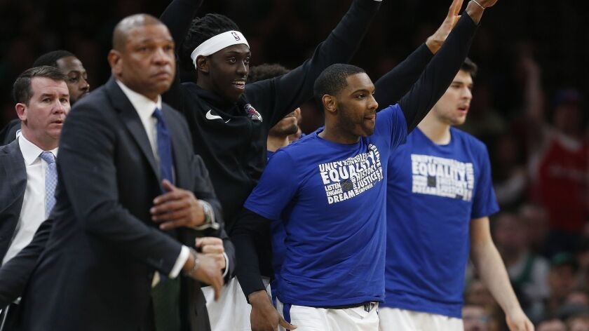 Clippers players reacts to a three-pointer by Landry Shamet as coach Doc Rivers looks on during Saturday's victory over the Boston Celtics.